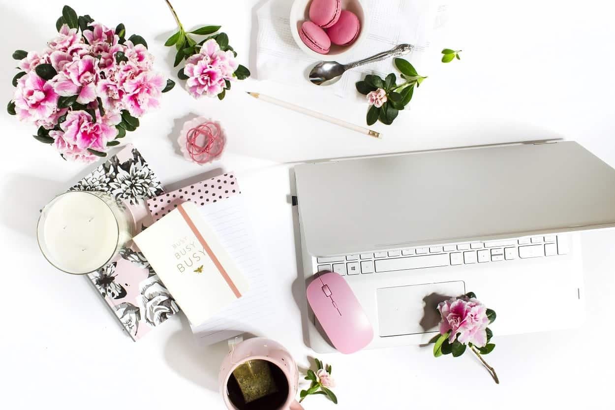 overwhelmed by blogging, messy desk, laptop, flowers
